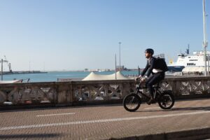 man riding electric bike to work commuter in suit