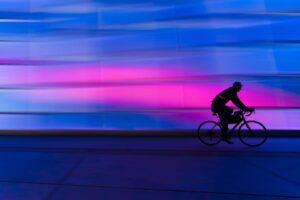 biker in the city neon lights dark