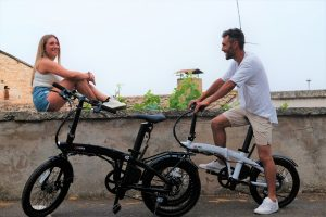 pair of people riding their electric bikes