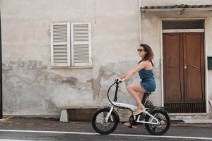 woman riding electric bike and getting a workout