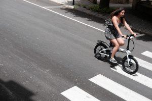 girl riding electric bike on street lower environmental impact