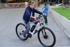 young child riding an electric bike